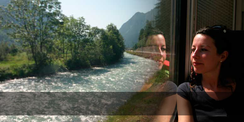 A girl admiring the scenery through the train window